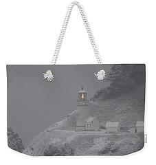 Heceta Lighthouse Snowstorm Weekender Tote Bag by Kenny Henson