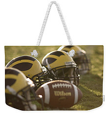 Helmets And A Football On The Field At Dawn Weekender Tote Bag