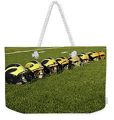 Helmets Of Different Eras On The Field Weekender Tote Bag