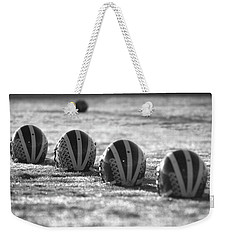 Helmets On Dew-covered Field At Dawn Black And White Weekender Tote Bag