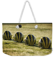 Helmets On Dew-covered Field At Dawn Weekender Tote Bag