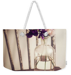 Weekender Tote Bag featuring the photograph Her Treasures by Amy Weiss