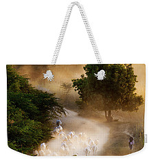 Weekender Tote Bag featuring the photograph herd and farmer going home in the evening, Bagan Myanmar by Pradeep Raja Prints