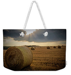 Weekender Tote Bag featuring the photograph Hey Bales And Sun Rays by David Dehner