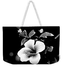 Weekender Tote Bag featuring the photograph Hibiscus In The Dark by Lori Seaman