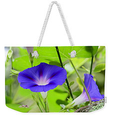 Weekender Tote Bag featuring the photograph Hidden Beauty by Corinne Rhode