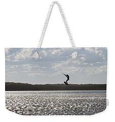 Weekender Tote Bag featuring the photograph High Jump  by Miroslava Jurcik