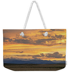 Weekender Tote Bag featuring the photograph High Plains Meet The Rocky Mountains At Sunset by James BO Insogna