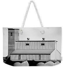 Weekender Tote Bag featuring the photograph High Rise by Stephen Mitchell