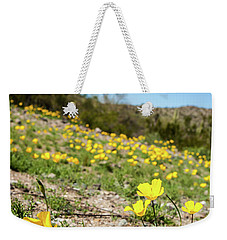 Weekender Tote Bag featuring the photograph Hillside Flowers by Ed Cilley