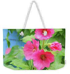 Weekender Tote Bag featuring the photograph Hollyhocks - 1 by Nikolyn McDonald