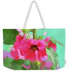 Weekender Tote Bag featuring the photograph Hollyhocks - 2  by Nikolyn McDonald