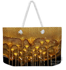 Weekender Tote Bag featuring the photograph Honey Drip by Stephen Mitchell