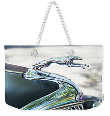 Weekender Tote Bag featuring the photograph Hood Ornament Ford by Theresa Tahara