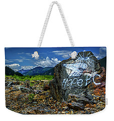 Weekender Tote Bag featuring the photograph Hope II by John Poon