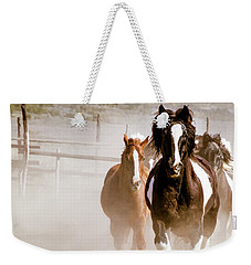 Weekender Tote Bag featuring the digital art Horses Running Into A Dusty Ranch Corral by Nadja Rider