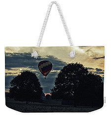 Hot Air Balloon Between The Trees At Dusk Weekender Tote Bag
