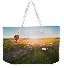 Weekender Tote Bag featuring the photograph Hot Air Balloon Taking Off At Sunrise by William Lee