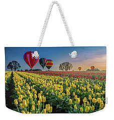 Weekender Tote Bag featuring the photograph Hot Air Balloons Over Tulip Fields by William Lee