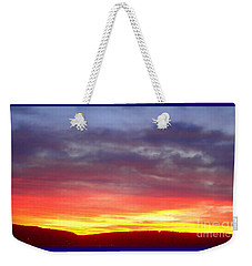 Weekender Tote Bag featuring the photograph Hot Time Tonight by Christina Verdgeline