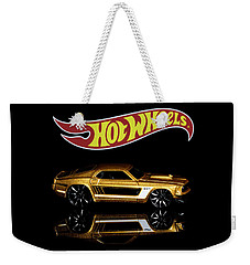 Weekender Tote Bag featuring the photograph Hot Wheels '69 Ford Mustang by James Sage
