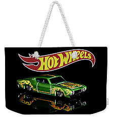 Weekender Tote Bag featuring the photograph  Hot Wheels '69 Ford Torino Talladega by James Sage