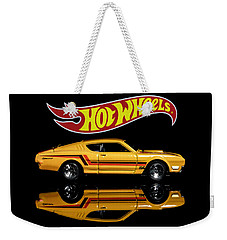 Weekender Tote Bag featuring the photograph  Hot Wheels '69 Mercury Cyclone by James Sage