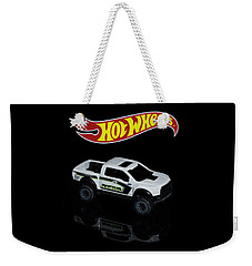 Weekender Tote Bag featuring the photograph Hot Wheels Ford F-150 Raptor by James Sage