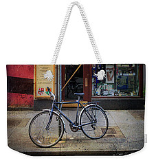 Weekender Tote Bag featuring the photograph House Of Names Bicycle by Craig J Satterlee