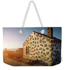 Weekender Tote Bag featuring the photograph House On The Cliff by Carlos Caetano