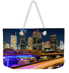 Weekender Tote Bag featuring the photograph Houston Skyline From I-45 by Andy Crawford