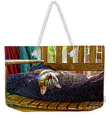 Weekender Tote Bag featuring the photograph How My Cat Looks When I Am On Acid by John Kolenberg