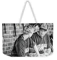 Weekender Tote Bag featuring the photograph How To Throw A Curve Ball by Benanne Stiens