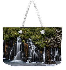 Weekender Tote Bag featuring the photograph Hraunfossar In The Gloom by Rikk Flohr