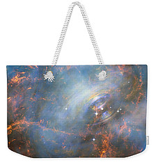 Weekender Tote Bag featuring the photograph Hubble Captures The Beating Heart Of The Crab Nebula by Nasa