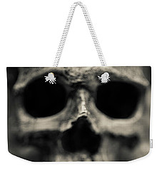 Weekender Tote Bag featuring the photograph Human Skull Among Flowers by Edward Fielding