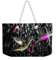 Weekender Tote Bag featuring the photograph Hummingbird Hovering In Rain With Splash by William Lee