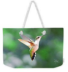 Weekender Tote Bag featuring the photograph Hummingbird Hovering by Meta Gatschenberger