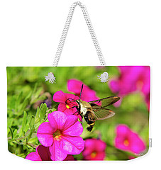 Weekender Tote Bag featuring the photograph Hummingbird Moth by Christina Rollo
