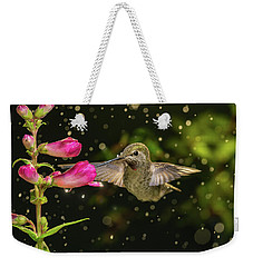 Weekender Tote Bag featuring the photograph Hummingbird Visits Flowers In Raining Day by William Lee
