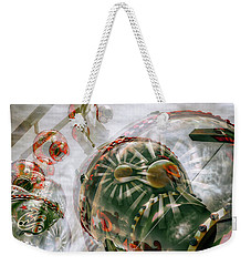 Weekender Tote Bag featuring the photograph Hung Up And Strung Out by Wayne Sherriff