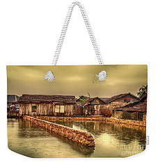 Weekender Tote Bag featuring the photograph Huts 2 by Charuhas Images