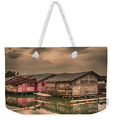 Weekender Tote Bag featuring the photograph Huts In South Sulawesi by Charuhas Images
