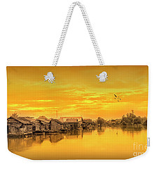 Weekender Tote Bag featuring the photograph Huts Yellow by Charuhas Images