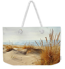Weekender Tote Bag featuring the photograph I Hear You Coming  by Kathi Mirto