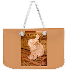 Weekender Tote Bag featuring the sculpture I Think I Lost A Slippper by Nancy Kane Chapman