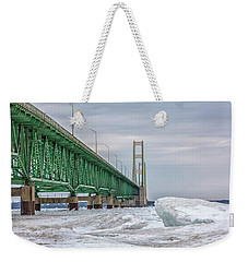 Weekender Tote Bag featuring the photograph Ice And Mackinac Bridge  by John McGraw