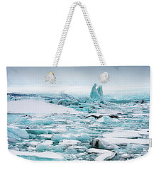 Weekender Tote Bag featuring the photograph Ice Galore In The Jokulsarlon Glacier Lagoon Iceland by Matthias Hauser