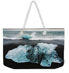 Weekender Tote Bag featuring the photograph Iceberg And Black Beach In Iceland by Matthias Hauser