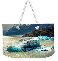 Weekender Tote Bag featuring the photograph Iceberg by Andrew Matwijec